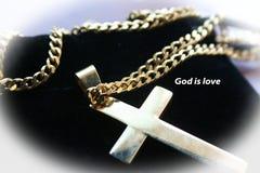 Het gouden Godsdienstige Kruis met `-God is Hoge Liefde ` - kwaliteit stock foto's