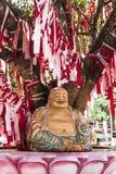 Het gouden standbeeld van glimlach Chinese Boedha royalty-vrije stock afbeelding