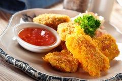 Het goudklompje van de kip Stock Fotografie