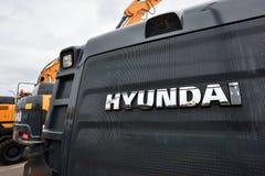Het Graafwerktuig en het embleem van Hyundai Stock Afbeeldingen