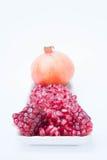 Het granaatappelfruit is rijk aan vitaminen Eet een fruit of een sap Royalty-vrije Stock Foto's
