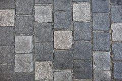 Het graniet cobblestoned bestrating stock foto's