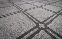 Het graniet cobblestoned bestratingsachtergrond met regelmatig ontwerp stock fotografie