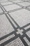 Het graniet cobblestoned bestratingsachtergrond met regelmatig ontwerp stock foto's