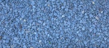 Het granietgrint van macadam, schommelt blauwe grijs ter plaatse verpletterd voor bouw, de achtergrond van de Puinkegeltextuur royalty-vrije stock foto's