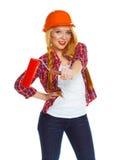 Het grappige meisje in een helm met in hand rol het is geïsoleerd op Stock Afbeeldingen