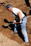 Het graven van de mens Stock Foto's