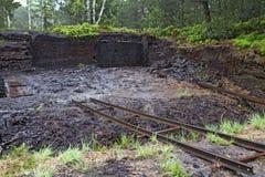 Het graven van de turf in een hoogland legt vast Royalty-vrije Stock Afbeeldingen
