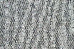 Het grijs breit textuur stock afbeeldingen