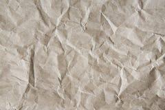 Het grijs-bruin verfrommelde verpakkend die document achtergrond, textuur van grijs van oud uitstekend document wordt gerimpeld royalty-vrije stock fotografie