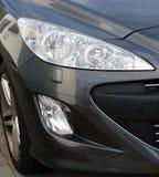 Het grijs van de sportwagenkoplamp Stock Foto