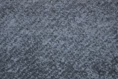 Het grijze, concrete muurclose-up, heeft een zeer interessante textuur stock foto