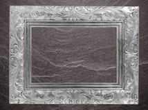 Het grijze kader van de kader Uitstekende foto op de marmeren achtergrond van de steenmuur Stock Foto