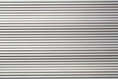het grijze patroon van de het pakhuismuur van het kleurenmetaal Royalty-vrije Stock Foto's