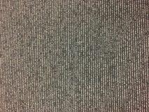 Het grijze tapijt van de kleurenvloer Stock Foto's