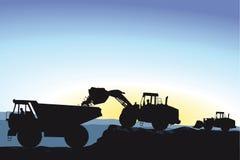 Het grint of de grond van de bulldozerlading Stock Afbeeldingen