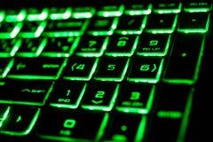 het groene fluorescente computertoetsenbord Stock Foto's