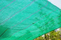 Het groene netto in de schaduw stellen stock afbeeldingen