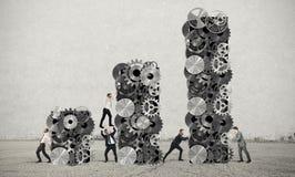Het groepswerk bouwt collectieve winst Stock Afbeelding