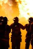 Het groepswerk van de brandbestrijder Stock Foto's