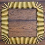 Het grote kaliber bullets vierkante achtergrond Stock Fotografie