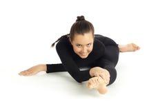 Het gymnastiek- stellen op wit Stock Foto