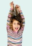 Het haar van het meisje pullng stock foto's