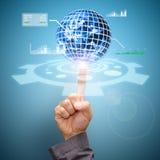 Het handpunt aan de wereld van mededeling en financieel Royalty-vrije Stock Afbeelding