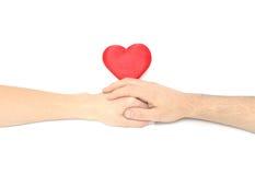 Het hart en de handen. stock afbeeldingen