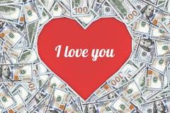 Het hart gaf teken gestalte met vele 100 die dollarsbankbiljetten wordt op wit worden geïsoleerd gemaakt dat Royalty-vrije Stock Foto's