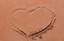 Het hart handwrited op zand Stock Fotografie