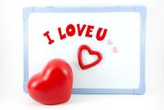 Het hart met I-liefde u verwoordt op witte raad royalty-vrije stock afbeelding
