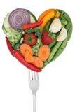 Het hart van de groentenliefde op een vork Stock Afbeeldingen