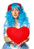 Het hart van de het meisjesholding van de clown Royalty-vrije Stock Fotografie