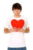 Het hart van de jonge mensenholding stock fotografie
