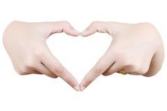 Het hart van de liefde maakt door geïsoleerde hand. Royalty-vrije Stock Afbeelding