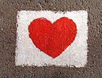 Het hart van de liefde in witte rechthoek stock foto