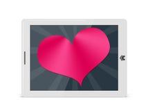 Het hart van de valentijnskaart op digitaal stootkussen Royalty-vrije Stock Fotografie