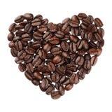 Het hart van koffiebonen op witte dichte omhooggaand wordt geïsoleerd die als achtergrond royalty-vrije stock foto