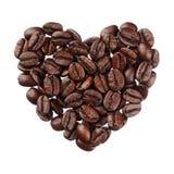 Het hart van koffiebonen op witte dichte omhooggaand wordt geïsoleerd die als achtergrond royalty-vrije stock foto's