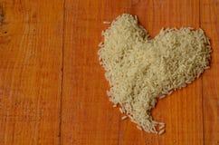 """Het hart van rijst wordt gemaakt die Rijst, liefde, hart, reis, arroz, riso, riz, Ñ€Ð¸Ñ , liebe, amor, amore, avontuurtje, Ð"""" ÑŽ Royalty-vrije Stock Afbeeldingen"""