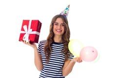 Het heden en de ballons van de vrouwenholding Royalty-vrije Stock Foto
