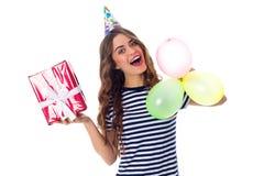 Het heden en de ballons van de vrouwenholding Royalty-vrije Stock Afbeelding