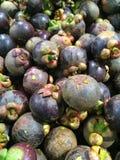 Het heerlijke mangostanfruit schikte op een achtergrond, Mangostanvlees, hoogste mening Royalty-vrije Stock Afbeeldingen