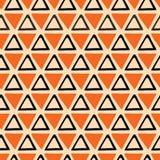 Het heldere abstracte Naadloze oranje en zwarte patroon van Halloween maakte van hand getrokken driehoeken Stock Afbeelding