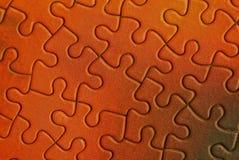 Het heldere oranje deel van het raadsel stock foto