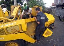 Het herstellen van asfaltafwerker Stock Fotografie