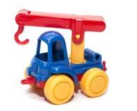 Het hijsen van kraanstuk speelgoed op een witte geïsoleerde achtergrond, Stock Afbeelding