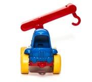 Het hijsen van kraanstuk speelgoed op een witte geïsoleerde achtergrond, Royalty-vrije Stock Afbeelding