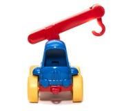 Het hijsen van kraanstuk speelgoed op een witte geïsoleerde achtergrond, Royalty-vrije Stock Foto